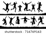 silhouette of people jumping on ... | Shutterstock .eps vector #716769163