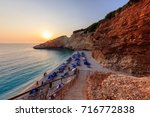 sunset in porto katsiki beach.... | Shutterstock . vector #716772838