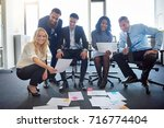 portrait of a diverse group of... | Shutterstock . vector #716774404