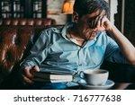mature handsome man feeling sad ... | Shutterstock . vector #716777638