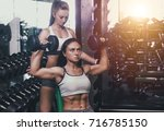 beautiful athlete woman... | Shutterstock . vector #716785150