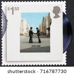 Small photo of Milan, Italy - September 1, 2017: Cover of Wish you were here by Pink floyd on stamp