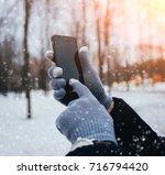 Man Using Smartphone In Winter...