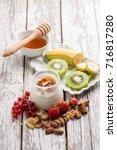 breakfast jar with yogurt ... | Shutterstock . vector #716817280
