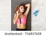 fitness woman have rest top... | Shutterstock . vector #716817628