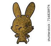 curious bunny cartoon   Shutterstock .eps vector #716828974