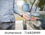 a young guy opens the door to a ...   Shutterstock . vector #716828989