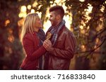 young couple in love walking in ... | Shutterstock . vector #716833840