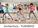 young group of exercisers doing ... | Shutterstock . vector #716838043