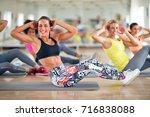 attractive women train in group ... | Shutterstock . vector #716838088