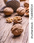 Small photo of Walnut. Walnut kernels and whole walnuts on rustic old oak table.