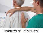 man having chiropractic back... | Shutterstock . vector #716843593