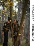 couple in the autumn forest on... | Shutterstock . vector #716844388