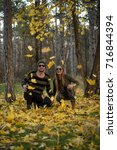 couple in the autumn forest on... | Shutterstock . vector #716844394