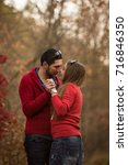 couple in the autumn forest on... | Shutterstock . vector #716846350
