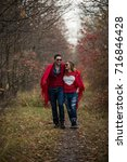 couple in the autumn forest on... | Shutterstock . vector #716846428