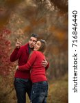 couple in the autumn forest on... | Shutterstock . vector #716846440
