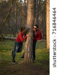 couple in the autumn forest on... | Shutterstock . vector #716846464