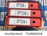 Small photo of Option 1, Option 2, Option 3 concept words. Folder concept. Ring binders.