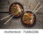 two wok food dish on the wooden ... | Shutterstock . vector #716862286