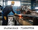 asian worker wearing protective ... | Shutterstock . vector #716869906