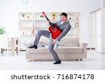 businessman celebrating going... | Shutterstock . vector #716874178
