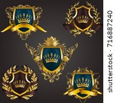 set of golden royal shields... | Shutterstock .eps vector #716887240