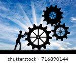 silhouette of a businessman... | Shutterstock . vector #716890144
