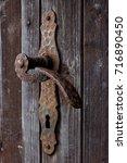 close up of the old rusty door...   Shutterstock . vector #716890450