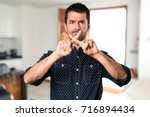 brunette man making no gesture... | Shutterstock . vector #716894434