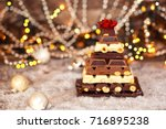 chocolate christmas pyramid as... | Shutterstock . vector #716895238
