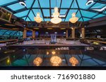 reflection of chandeliers at... | Shutterstock . vector #716901880