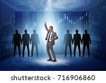 businessman in the spotlight in ...   Shutterstock . vector #716906860