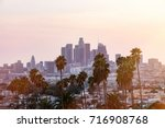 los angeles skyline at sunset | Shutterstock . vector #716908768