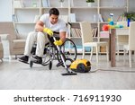 disabled man with vacuum... | Shutterstock . vector #716911930