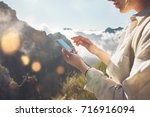 young traveling woman standing... | Shutterstock . vector #716916094