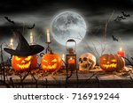 halloween pumpkins on wooden... | Shutterstock . vector #716919244