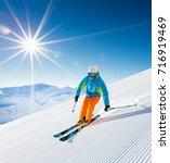 skier skiing downhill during... | Shutterstock . vector #716919469