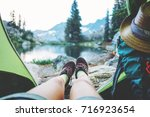 young woman traveler sitting... | Shutterstock . vector #716923654