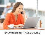happy customer in orange using... | Shutterstock . vector #716924269
