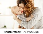 portrait of happy laughing baby ... | Shutterstock . vector #716928058