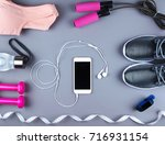 flat lay shot of sneakers ... | Shutterstock . vector #716931154