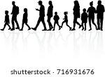 people walking  black...   Shutterstock .eps vector #716931676