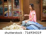 Young Asian Woman Spinning...