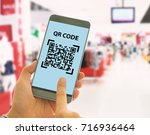 scan the qr code to a smart... | Shutterstock . vector #716936464