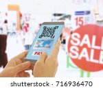 scan the qr code to a smart... | Shutterstock . vector #716936470