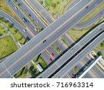 aerial view traffic road black...   Shutterstock . vector #716963314
