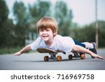 smiling little boy on... | Shutterstock . vector #716969758