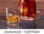 whiskey with ice | Shutterstock . vector #716975260