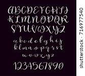 calligraphic vector script font.... | Shutterstock .eps vector #716977540